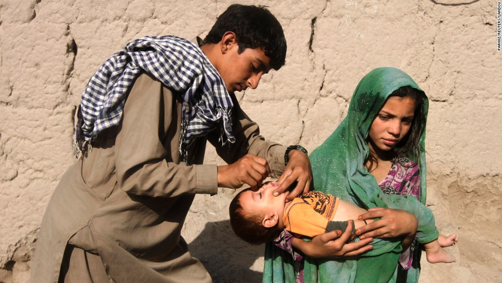 A child is vaccinated for polio on the outskirts of Jalalabad, Afghanistan, on Monday, August 18.