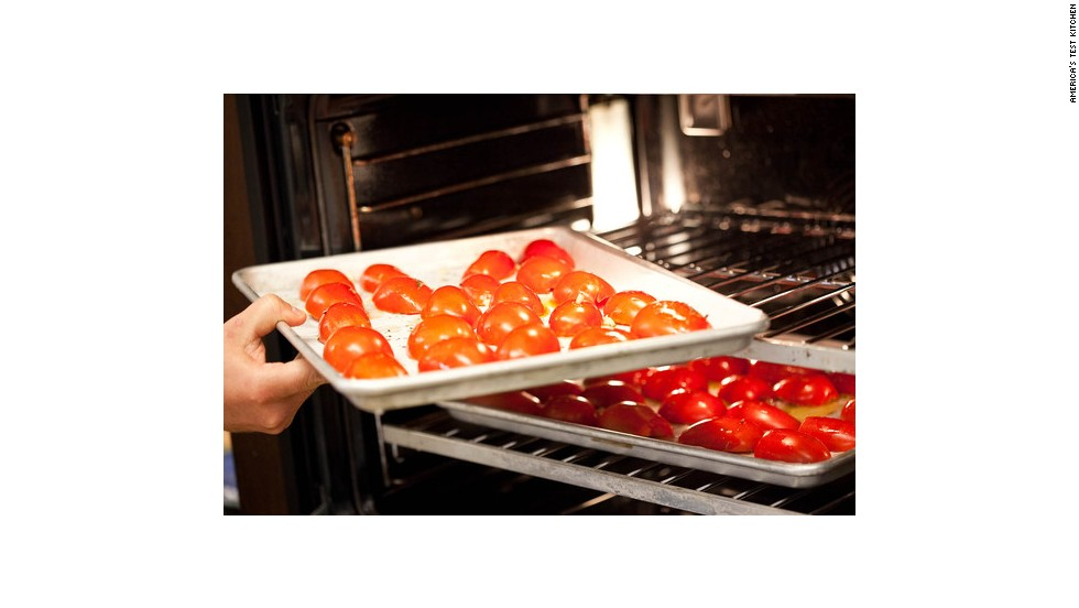 Place the tomatoes in a preheated 425-degree oven for 30 minutes (or until the skins wrinkle up a bit and start to get brown in places).