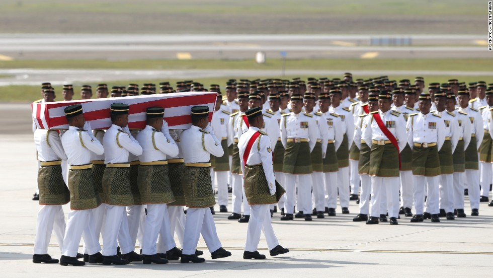 Malaysian Army soldiers carry a coffin containing the remains of one of the passengers aboard Flight MH17, which was shot down over eastern Ukraine last month.