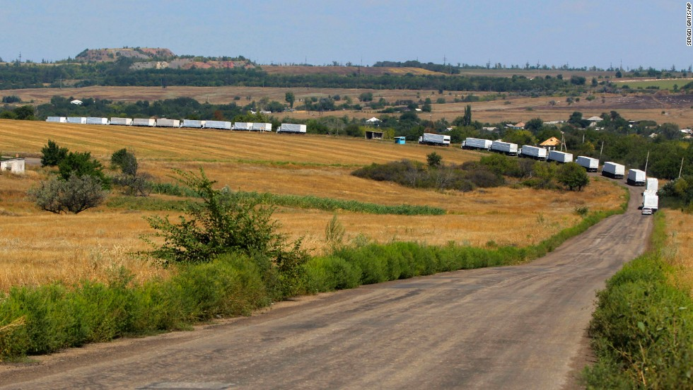 "The first trucks of a Russian aid convoy roll on the main road to Luhansk in eastern Ukraine on Friday, August 22. The head of Ukraine's security service called the convoy a ""direct invasion"" under the guise of humanitarian aid since it entered the country without Red Cross monitors."