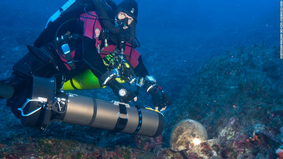 """Foley said: """"It's actually a treasure ship and there are just no two ways about it. There are 36, 38 statues of marble and bronze, gold jewelry, very high quality glass artifacts that came from the East Mediterranean. Just the highest quality stuff that was available in the first and second centuries BC."""" Pictured, technical diver Phillip Short inspects an amphora on a previous reconnaissance dive."""