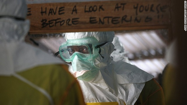 A Doctors Without Borders worker prepares to enter a high-risk area of an Ebola treatment center in Liberia.