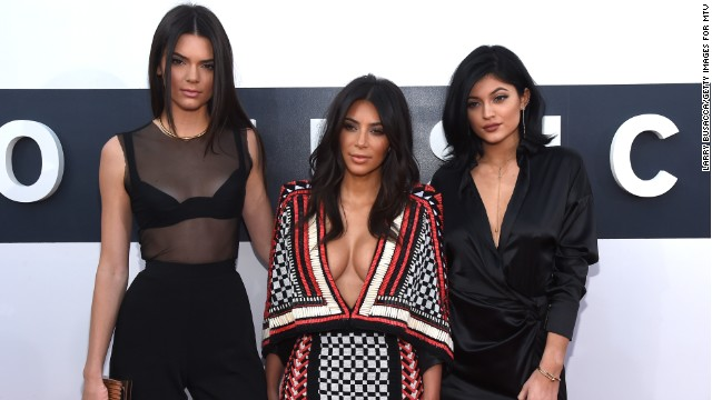 INGLEWOOD, CA - AUGUST 24:  (L-R) TV personalities Kendall Jenner, Kim Kardashian and Kylie Jenner attend the 2014 MTV Video Music Awards at The Forum on August 24, 2014 in Inglewood, California.  (Photo by Larry Busacca/Getty Images for MTV)