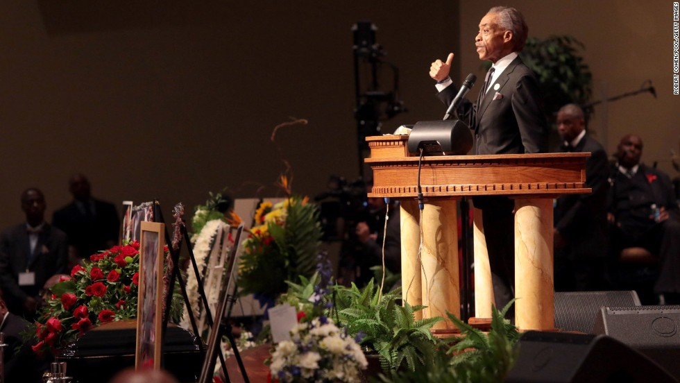 The Rev. Al Sharpton speaks during the funeral.