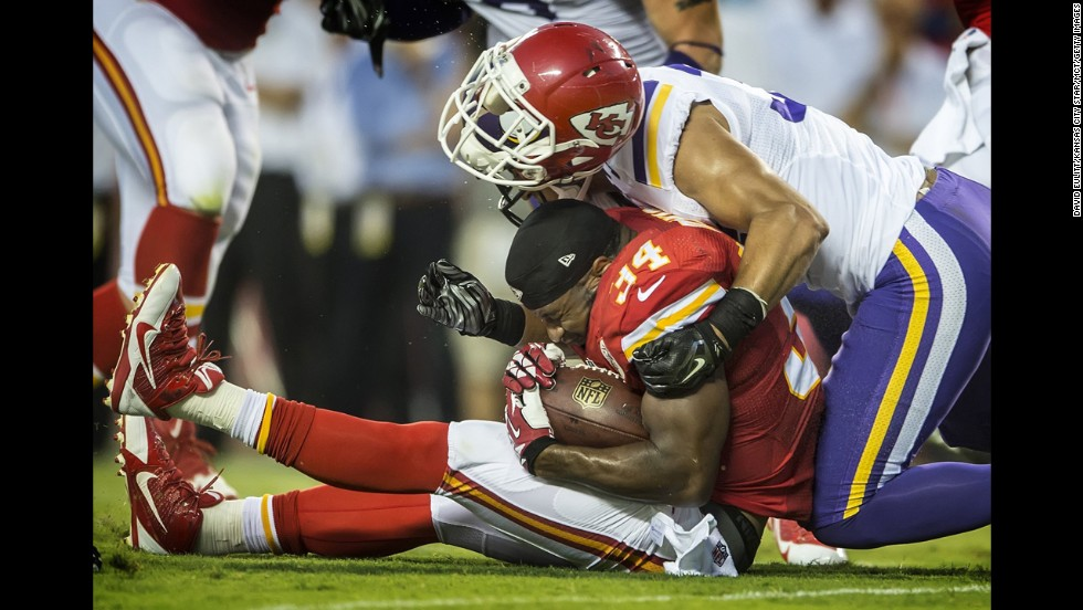 Kansas City Chiefs running back Knile Davis loses his helmet on a tackle by Minnesota Vikings defensive back Robert Blanton in the second quarter of a NFL preseason game in Kansas City, Missouri, on Saturday, August 23. The Vikings won 30-12.