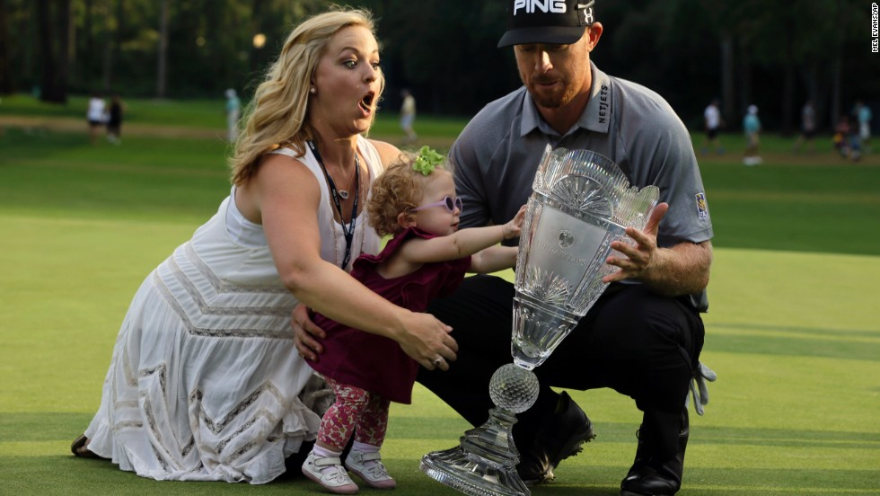 Hunter Mahan poses with the Barclays trophy alongside his wife and daughter on Sunday, August 24, in Paramus, New Jersey.