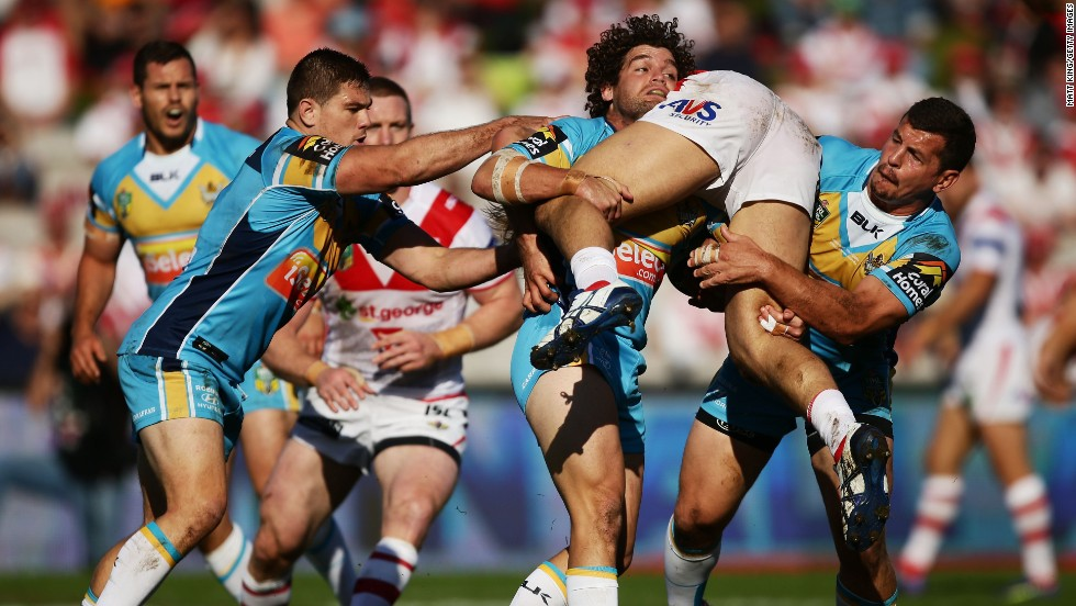 Jack de Belin of the St. George Illawarra Dragons is tackled during the round 24 National Rugby League match against the Gold Coast Titans on Sunday, August 24, in Sydney, Australia. The Dragons won 34-6.
