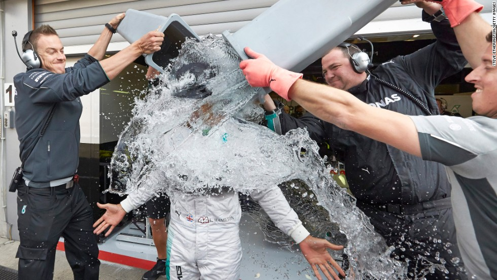 Lewis Hamilton of Great Britain and Mercedes GP takes part in the ALS ice bucket challenge outside the team garage ahead of the Belgian Grand Prix on Friday, August 22, in Spa, Belgium.