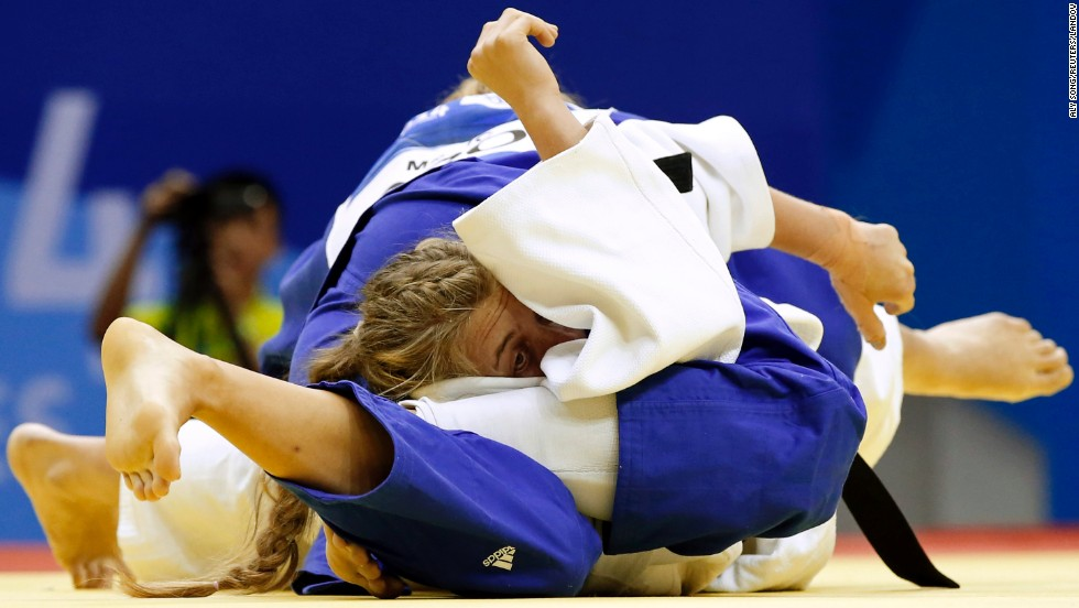 South Africa's Unelle Snyman, in white, fights against Croatia's Brigita Matic during a women's -78 kg semifinal judo match at the 2014 Youth Olympic Games in Nanjing, China, on Tuesday, August 19.
