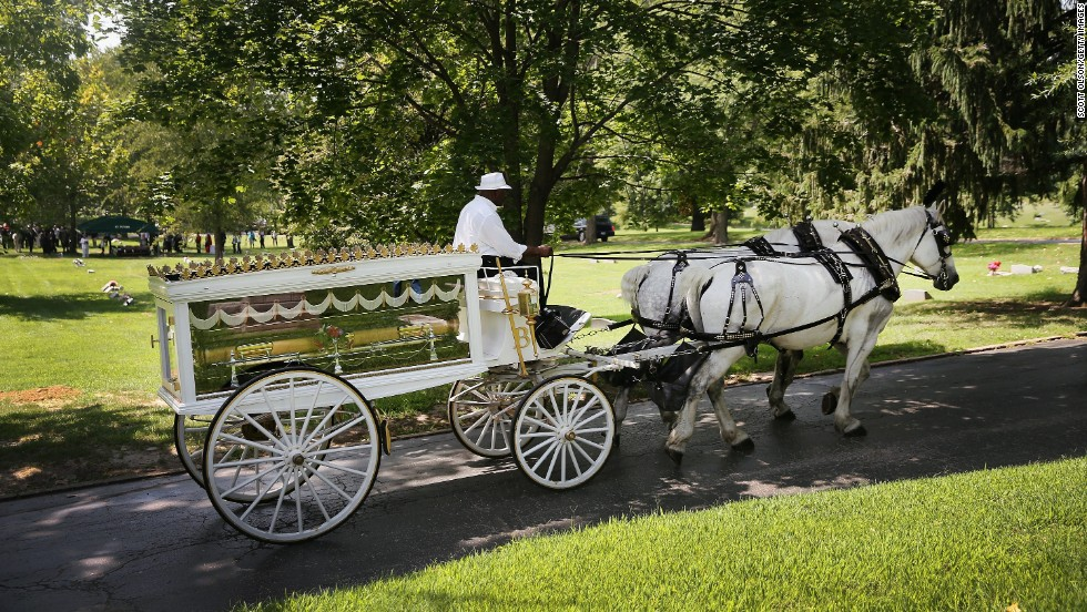 Michael Brown's casket arrives at St. Peter's Cemetery on Monday, August 25, 2014 for his funeral. Brown, 18, was shot and killed by police Officer Darren Wilson on August 9 in Ferguson, Missouri. Brown's death sparked protests in the St. Louis suburb, and a national debate about race and police actions.