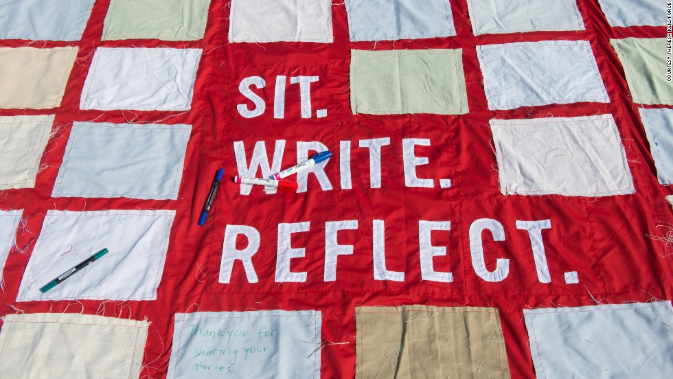 People contribute to the quilt in different ways. Some people make squares ahead of time in workshops led by community organizations. When it's on public display, visitors are invited to share stories in designated places on the quilt.