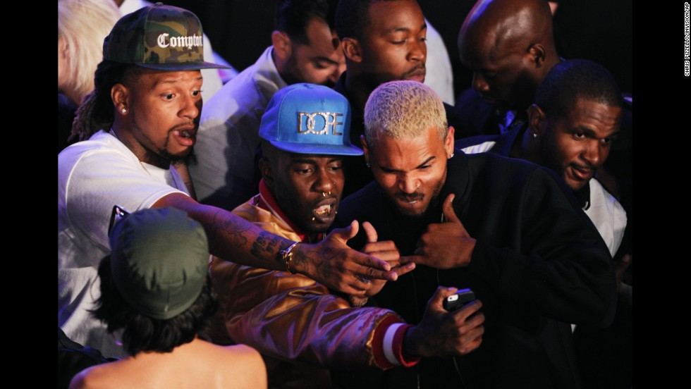"Chris Brown, right, poses for a selfie with fans at the 2014 BMI R&B Hip Hop Awards at the Pantages Theatre on Friday, August 22. Brown received a special citation of achievement recognizing over 1 million broadcast performances of his hit ""Forever."""