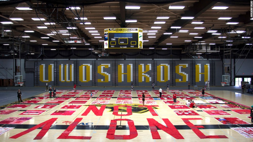 "The quilt visited the University of Wisconsin-Oshkosh on August 19, where organizers used fabric to form the words ""Not Alone."" The Oshkosh visit was coordinated by REACH Counseling and the University of Oshkosh Women's Center."