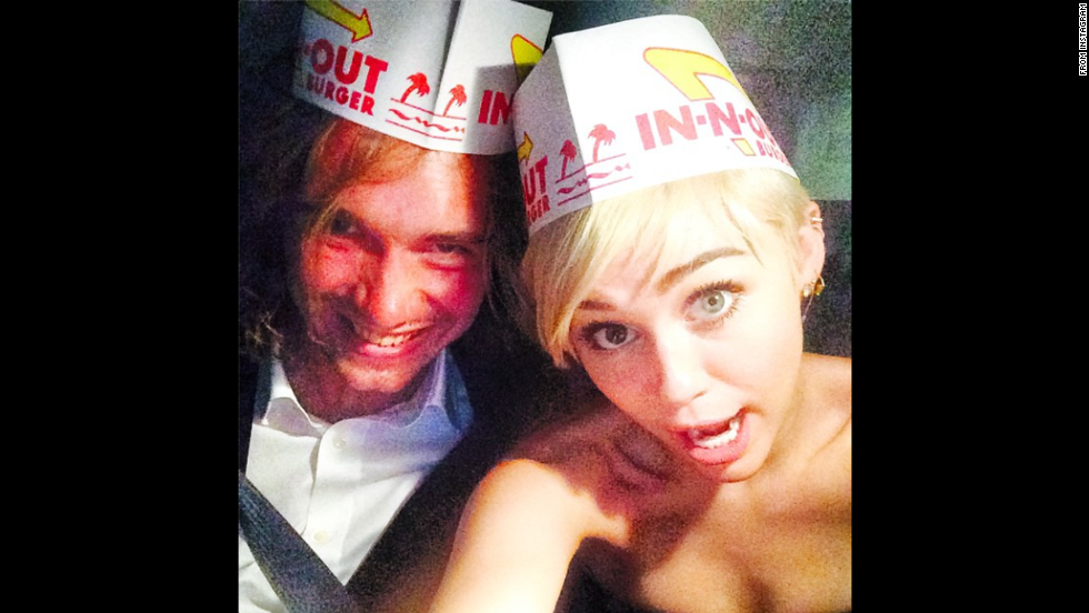 Out celebrating her VMA win for video of the year, actress and musician Miley Cyrus posted this selfie to Instagram on Monday, August 25. Cyrus made headlines yet again, when instead of accepting her award, she sent homeless teen Jesse Helt, left, to make a statement on teen homelessness.