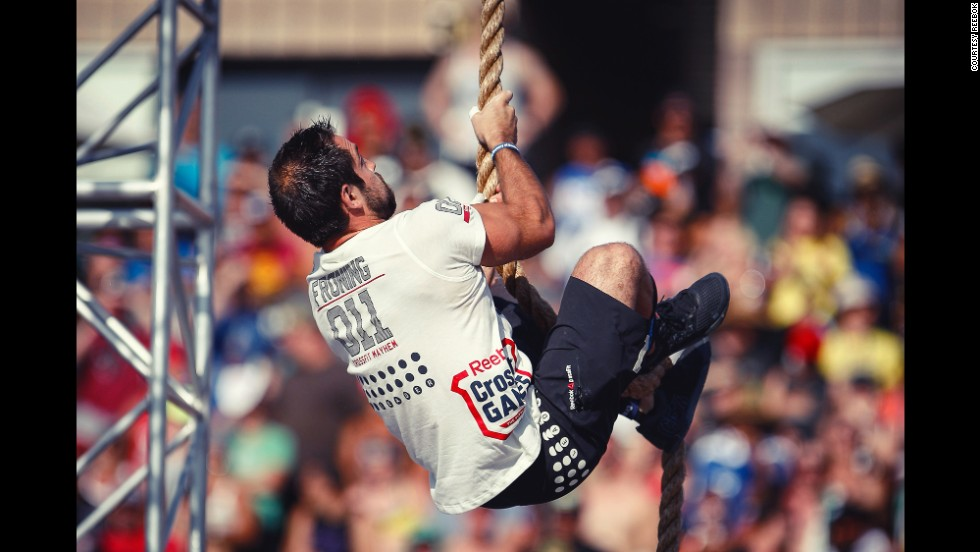 "Froning does a rope climb during the <a href=""http://games.crossfit.com/workouts/games"" target=""_blank"">Thick N' Quick event</a>. Athletes had to do four rope climbs and three overhead squats with 165 pounds in under 4 minutes."
