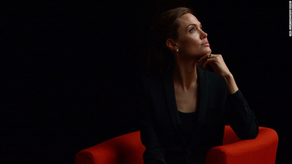 Jolie listens during to a speaker during the Global Summit to End Sexual Violence in Conflict in London on June 12.