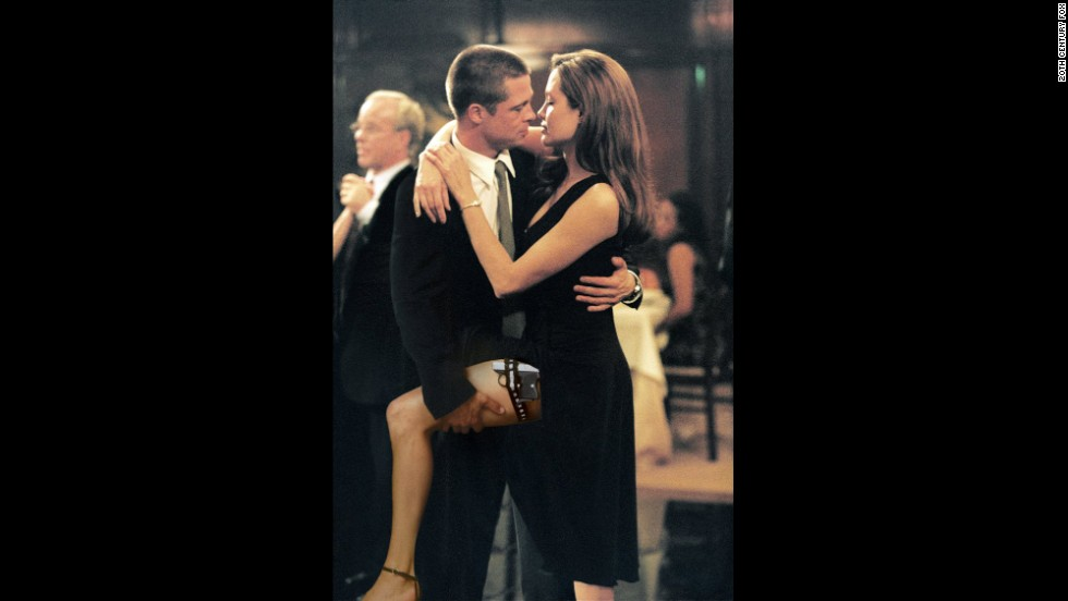 "Pitt and Jolie get close in a scene from their first film together ""Mr. and Mrs. Smith"" in 2005."