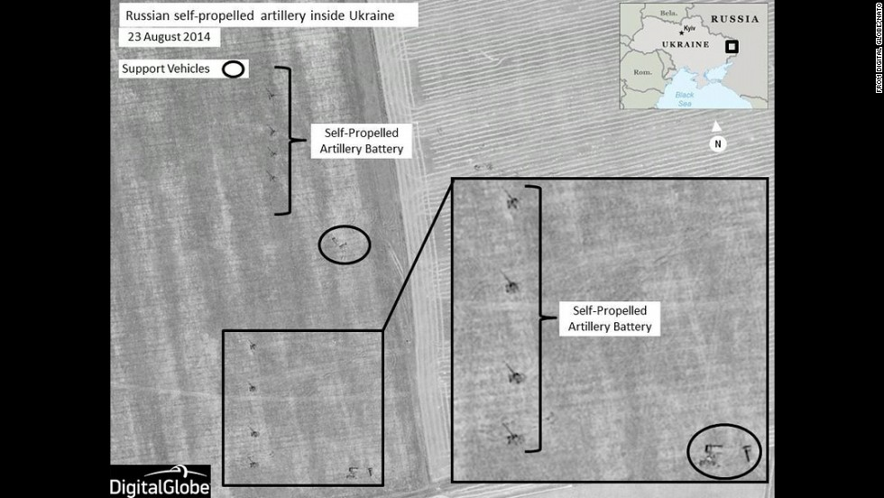 At a press conference on Thursday, August 28, Dutch Brig. Gen. Nico Tak, a senior NATO commander, revealed satellite images of what NATO says are Russian combat forces engaged in military operations in or near Ukrainian territory. NATO said this image shows Russian self-propelled artillery units set up in firing positions near Krasnodon, in eastern Ukraine.