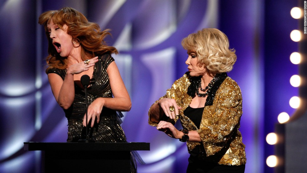 Kathy Griffin is one of many comedians who can cite Rivers as an influence. Like Rivers, Griffin is known for mocking celebrities at various events. Here, she and Rivers share a stage during a Rivers roast in 2009.