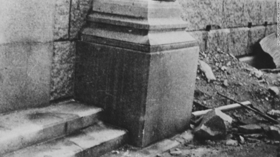 """In June 1946, the """"shadow"""" of a victim, left, remains on some steps after the atomic bombing of the Japanese city of Hiroshima in August 1945. The person had been sitting on the steps when the heat from the explosion burned the surface of the stone around the victim's body."""