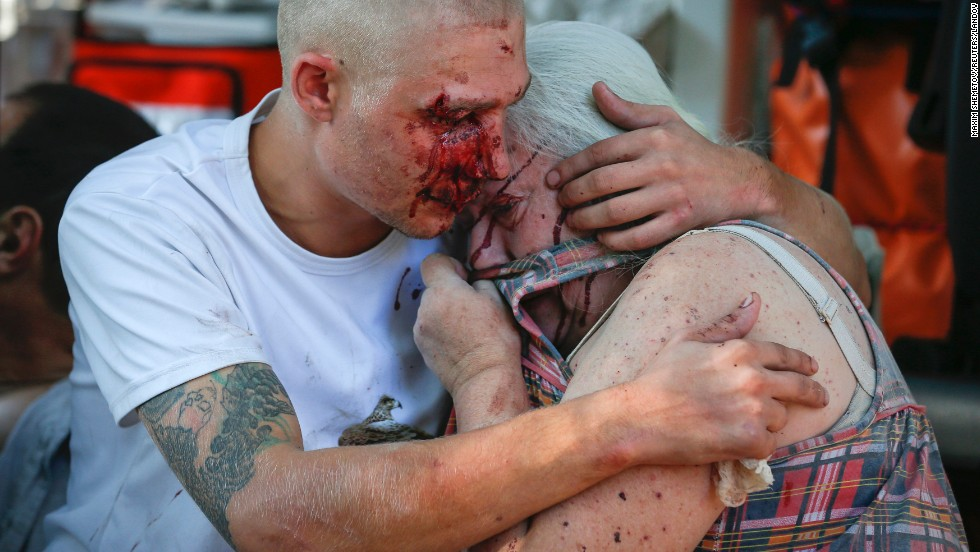 "A man comforts a woman after they were both wounded by what locals say was recent shelling by Ukrainian forces in Donetsk on Saturday, August 23. <a href=""http://www.cnn.com/2014/08/07/europe/gallery/ukraine-crisis/index.html"">Ongoing clashes</a> between Ukrainian government troops and pro-Russian rebels have left more than 2,000 people dead since mid-April, according to estimates from U.N. officials."