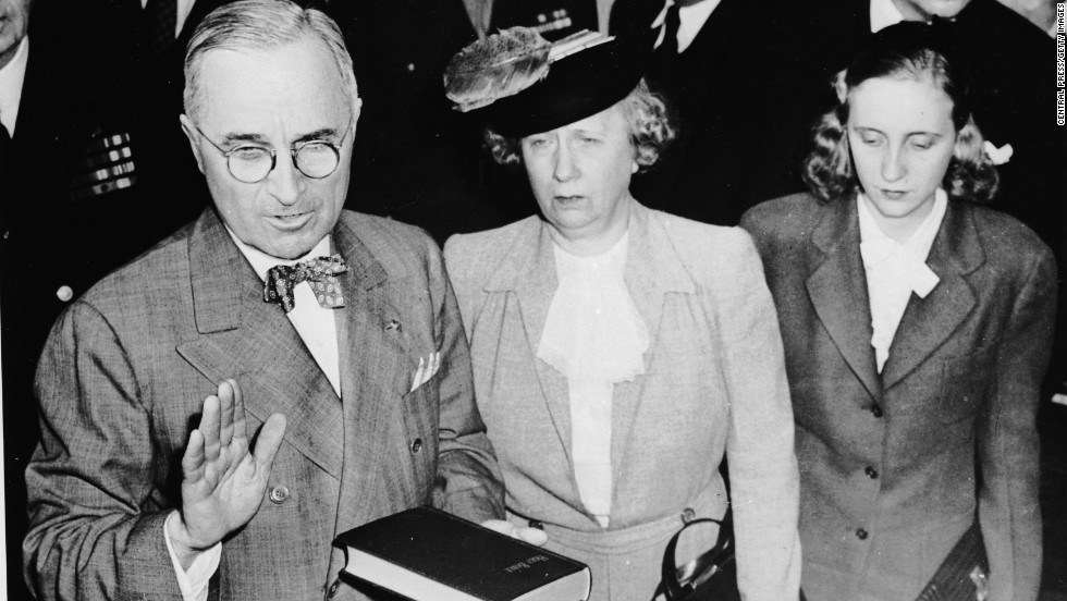 Harry S. Truman takes the oath of office on April 12, 1945, as he becomes the 33rd president of the United States. Standing beside him are his wife, Bess, and daughter Margaret.