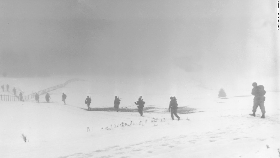 Soldiers of an infantry division move into the mist over a snow-covered field near Krinkelter, Belgium, on December 20, 1944, during the Battle of the Bulge, a surprise German counter-offensive against Allied forces as they closed in on German soil from the west. It resulted in more combined U.S. losses (nearly 90,000 killed, wounded or captured) than any battle of the war.