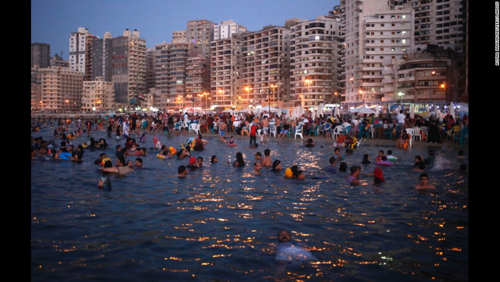 People relax at a public beach in Alexandria, Egypt, on Saturday, August 23.