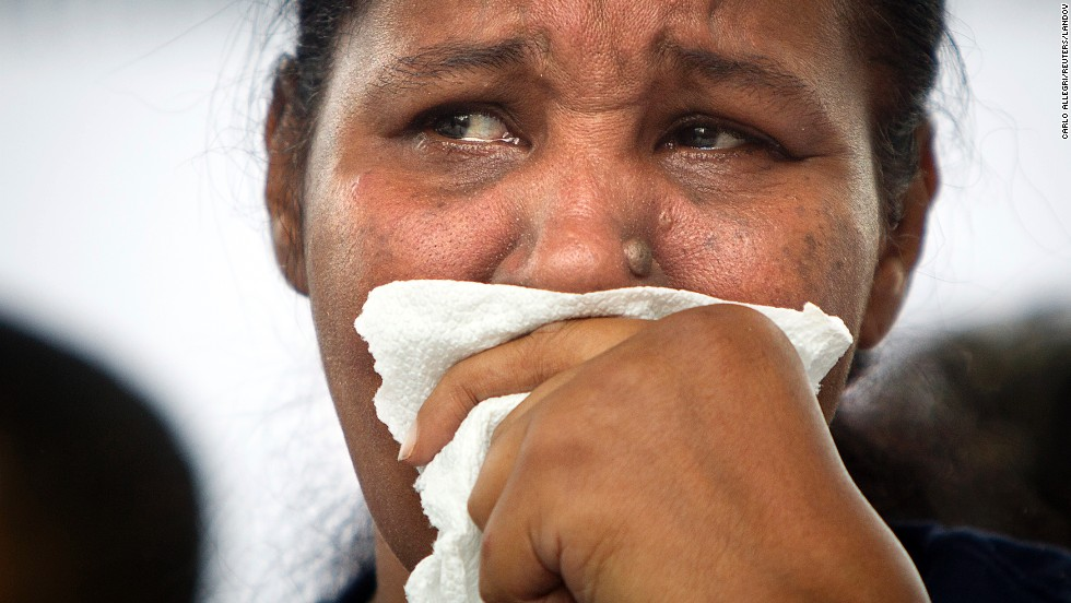 "Widow Esaw Garner cries on stage during <a href=""http://www.cnn.com/2014/08/23/us/new-york-choke-hold-rally/index.html"">a rally for her husband</a> in Staten Island, New York, on Saturday, August 23. Eric Garner, an unarmed black man, died after a white police officer put him in a chokehold on July 17, sparking national outrage."