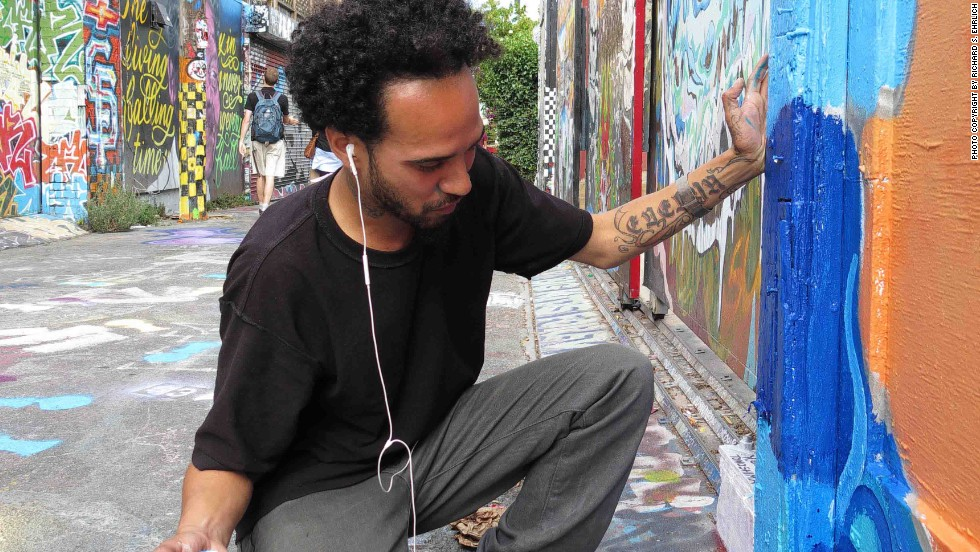Carlos Daniel Perez-Boza teaches art at San Francisco's Cultural Arts Division of the Recreation and Parks. Here he works on an authorized mural in Clarion Alley in the Mission District.