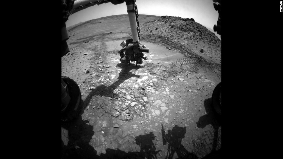"The Mars rover Curiosity does a test drill on a rock dubbed ""Bonanza King"" to determine whether it would be a good place to dig deeper and take a sample. But after the rock shifted, the test was stopped."
