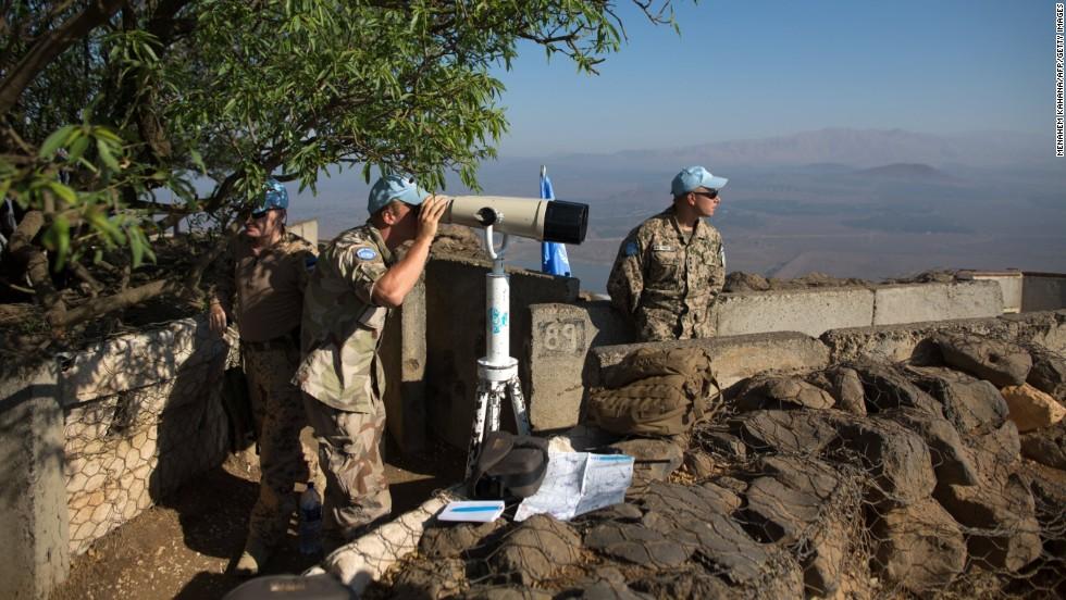 U.N. peacekeepers leave Syrian-controlled Golan - CNN.com