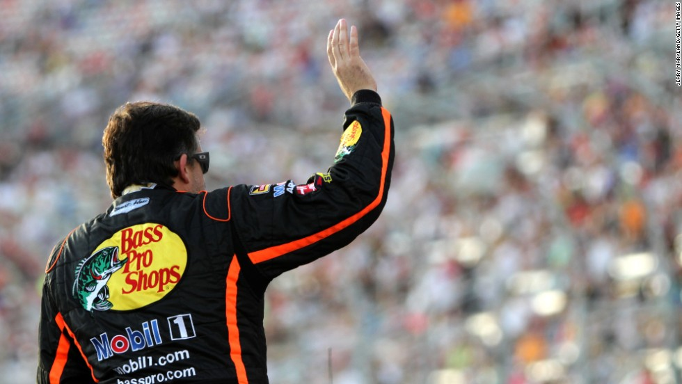 "NASCAR driver Tony Stewart waves to the crowd at Atlanta Motor Speedway prior to the Sprint Cup race there on Sunday, August 31. It was <a href=""http://www.cnn.com/2014/09/01/us/tony-stewart-return/index.html"">Stewart's first race</a> since August 9, when the car he was driving fatally struck Kevin Ward Jr. at a New York dirt track."