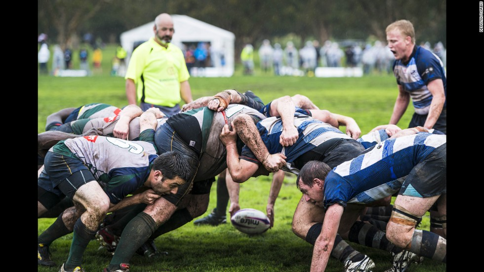 A rugby ball is held near a scrum during a Bingham Cup match in Sydney on Friday, August 29. The Bingham Cup is an international tournament that promotes gay-inclusive rugby clubs.