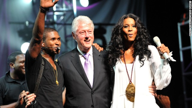 Clinton joins singers Usher and Ciara at the New Look Foundation's First Annual World Leadership Awards in 2010 in Atlanta.