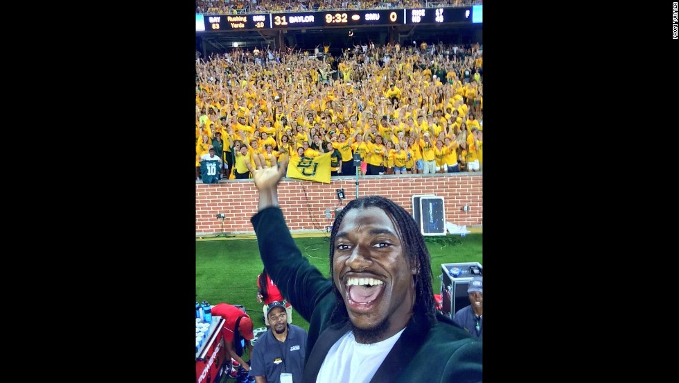 "Washington Redskins quarterback Robert Griffin III visited his alma mater, Baylor University, and <a href=""https://twitter.com/RGIII/status/506259004872744960"" target=""_blank"">tweeted this selfie</a> during the school's first football game of the season on Sunday, August 31. Baylor, in Waco, Texas, opened a brand-new stadium and unveiled a statue of Griffin, its only Heisman Trophy winner."