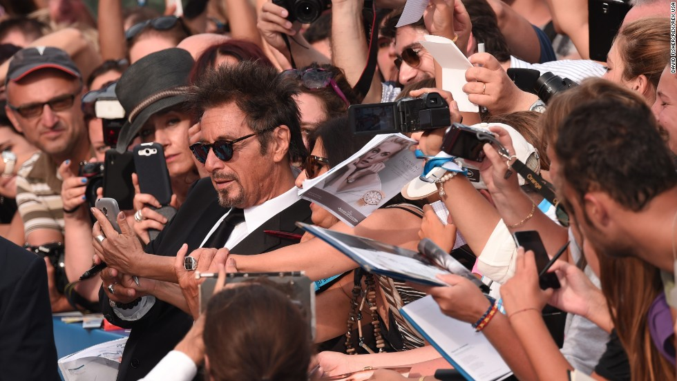 "Actor Al Pacino poses with fans during the ""Manglehorn"" film premiere Saturday, August 30, at the Venice Film Festival in Venice, Italy."
