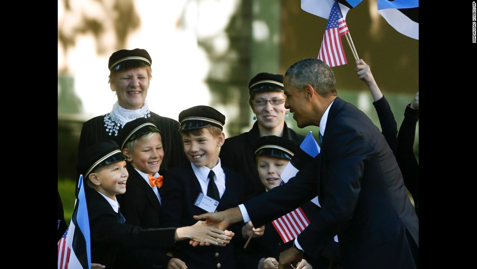 Children welcome Obama to Kadriorg Palace in Tallinn on September 3. Obama's visit to Estonia sought to reassure nervous Eastern European nations that NATO's support for its member states is unwavering.