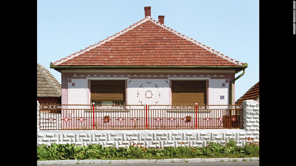 "Roters noticed the painted ""Magyar Kocka"", or Hungarian Cube, houses in 2003 after moving from Germany to a small Hungarian town."