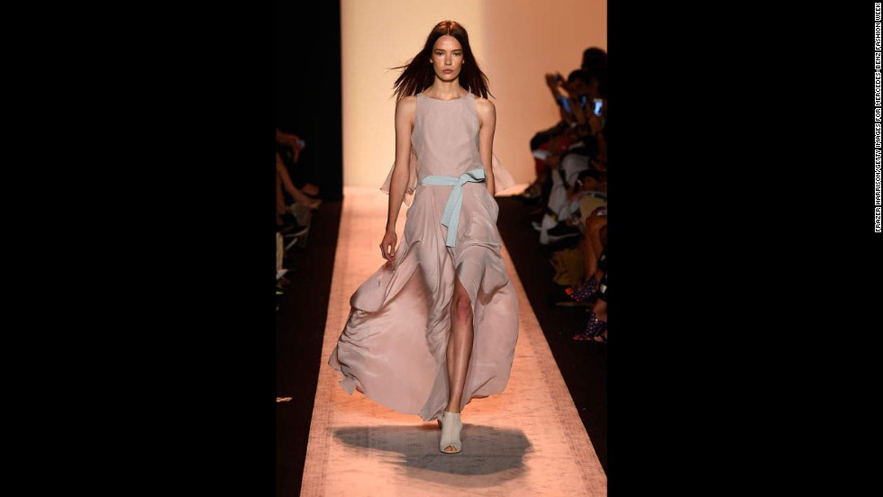 "During the BCBGMAXAZRIA show, a model walked the runway in a ""lavender mist"" silk dress with a light aqua stitched belt."