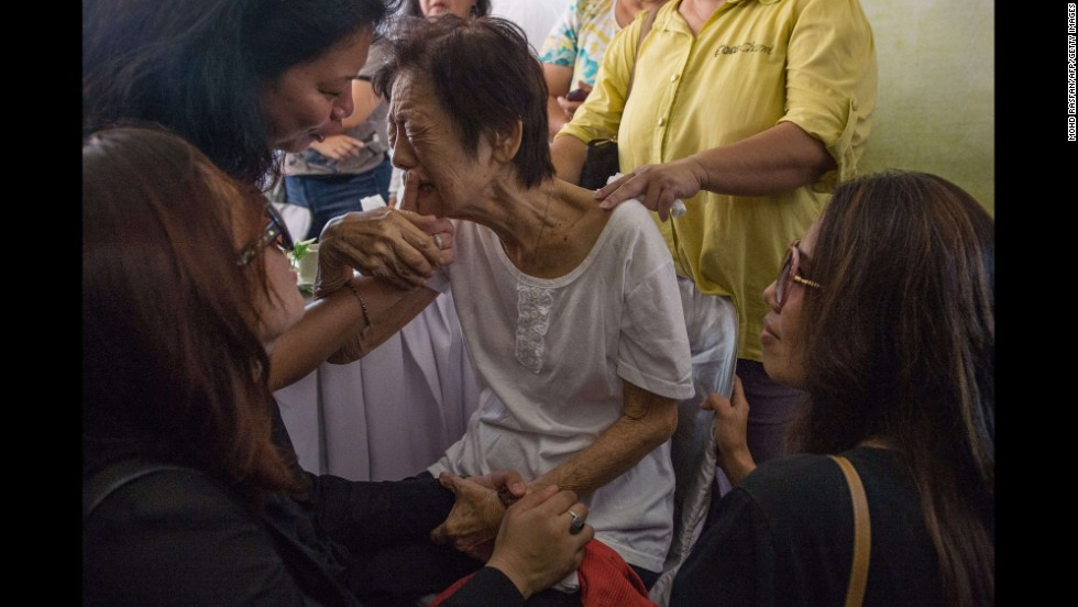 Chew Lai Choo cries Tuesday, September 2, during a wake service for her son-in-law Eugene Choo, who was on Malaysia Airlines Flight 17 when it was shot down over eastern Ukraine in July. The service was held at Eugene Choo's residence in Seremban, Malaysia.