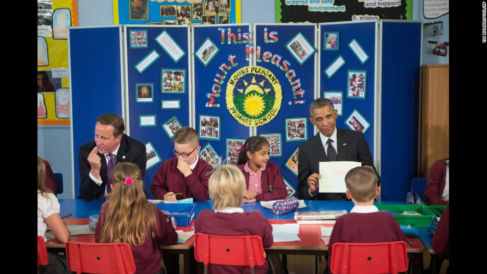 "U.S. President Barack Obama, right, and British Prime Minister David Cameron meet with schoolchildren in Newport, Wales, before attending a NATO summit on Thursday, September 4. The two-day summit is billed as the most important gathering of NATO leaders in more than a decade. <a href=""http://www.cnn.com/2014/09/03/politics/gallery/obama-europe-september/index.html"">See more photos from Obama's trip to Europe</a>"