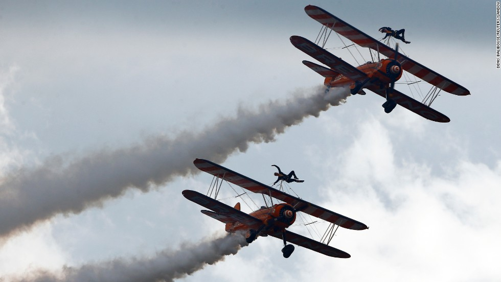 Members of the Breitling Wingwalkers perform during the Air14 air show Sunday, August 31, in Payerne, Switzerland.