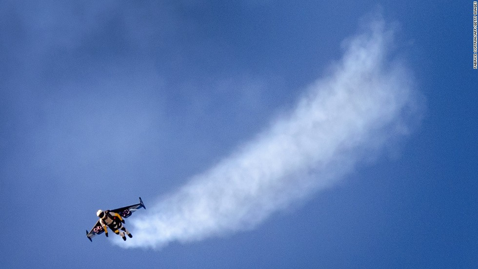 Swiss pilot Yves Rossy flies with jet-powered wings attached to his back Sunday, August 31, during the Air14 air show in Payerne, Switzerland.