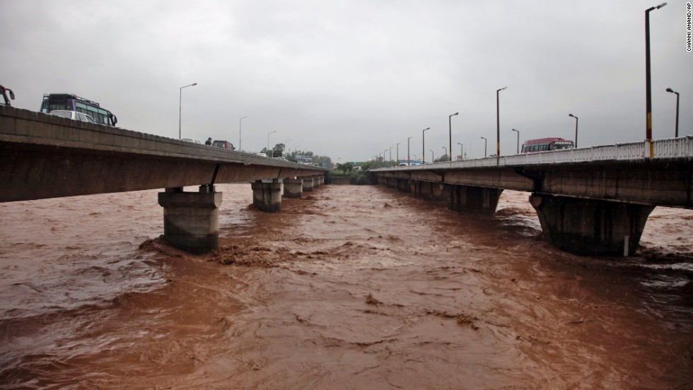 Floodwaters inch higher on a bridge September 5 in Jammu.