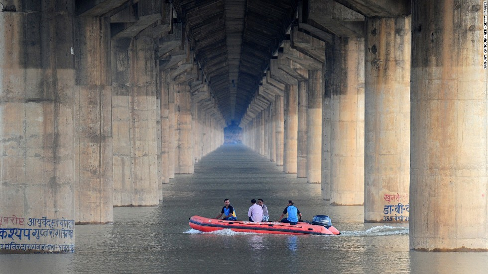 Police patrol the flooded River Ganga in Allahabad, India, on Tuesday, August 12.