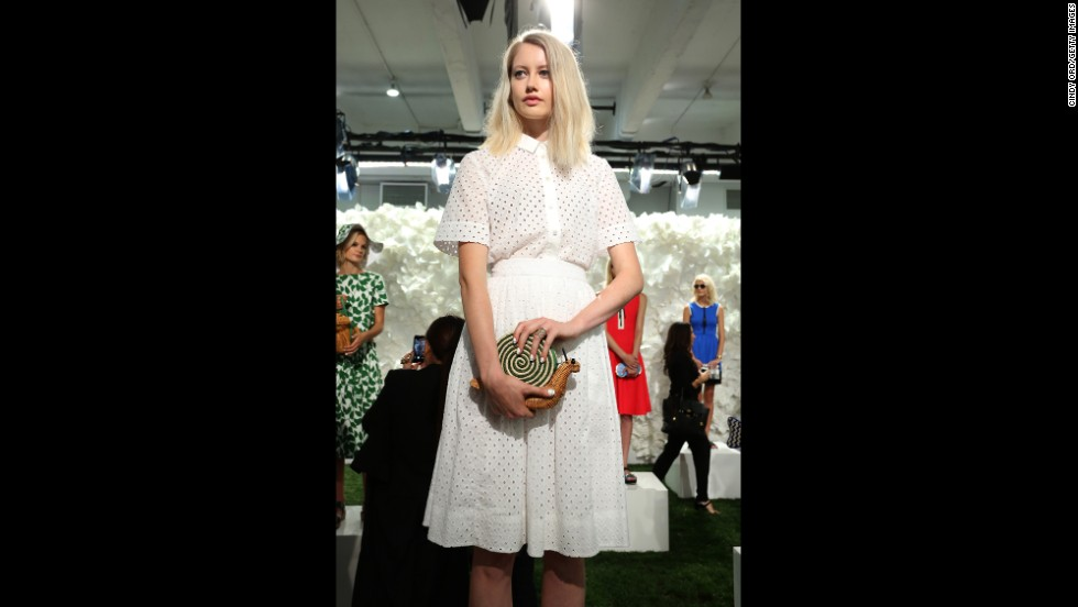 A model at Kate Spade posed with a snail-shaped wicker purse at the designer's September 5 presentation.