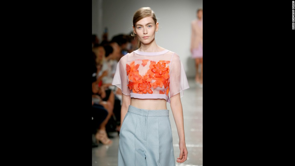 In this look, Rebecca Taylor paired a lilac flutter sleeve top with culottes.