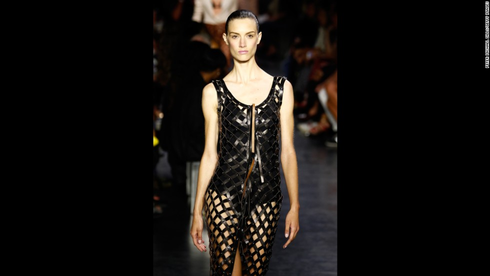 In a more daring look, Altuzarra crisscrossed strips of leather for this dress.
