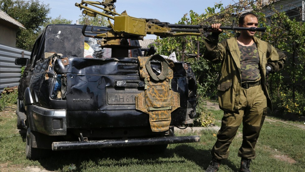 A pro-Russian rebel stands next to a truck with a heavy machine gun attached to it Sunday, September 7, in Donetsk.